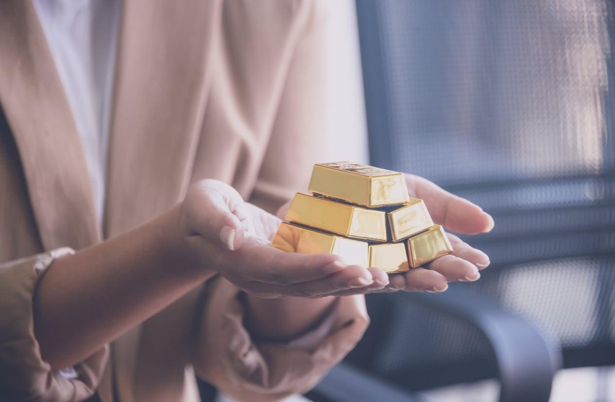 de l'or devant graphique boursier